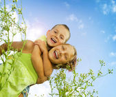 Happy Kids.Sister and Brother outdoor.Family — Stock Photo