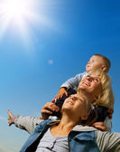Healthy Family Outdoor. Happy Mother With Kids Over Blue Sky — Stock Photo