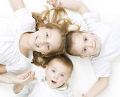 Kids. Happy Smiling Family over white — Stock Photo