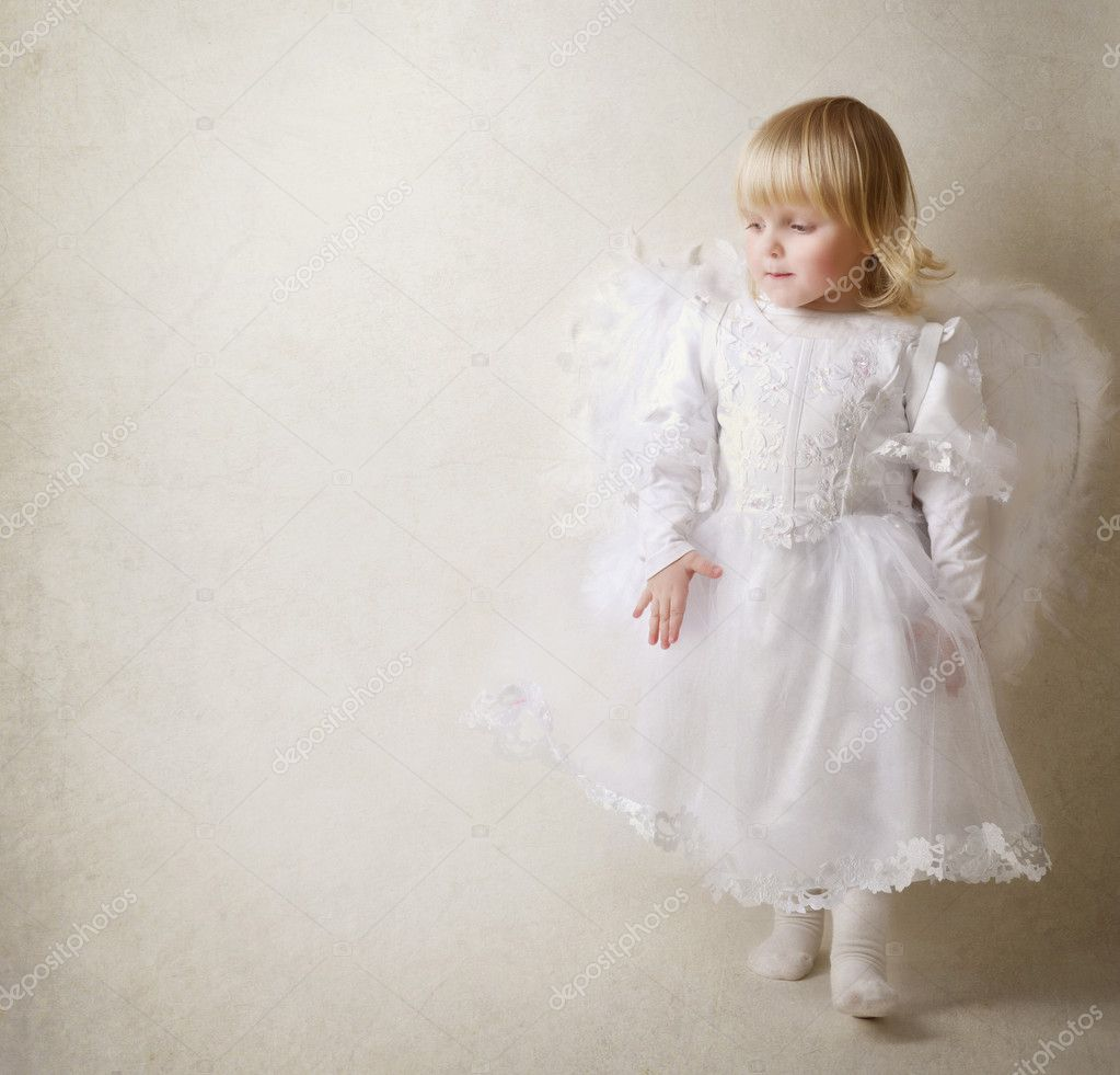 Baby girl in an angel dress — Stock Photo #10746666