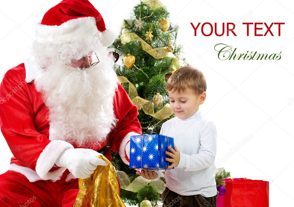 Santa Claus giving Christmas gifts to children — Stock Photo #10747044