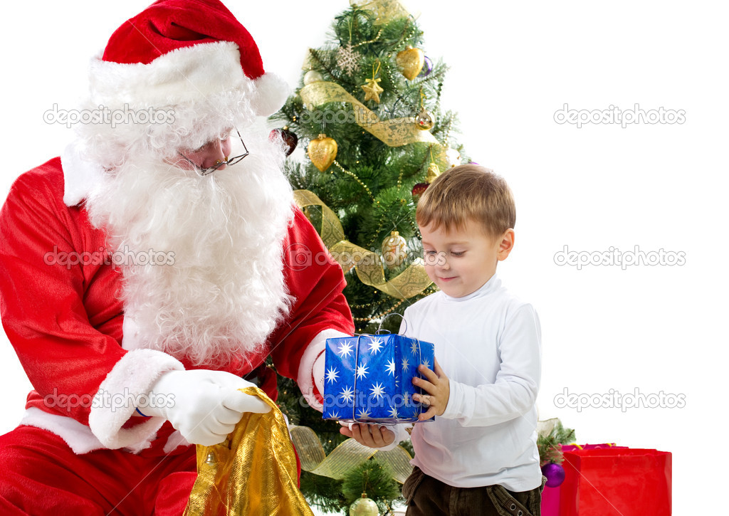 Santa Claus giving Christmas gifts to child — Stock Photo #10747047