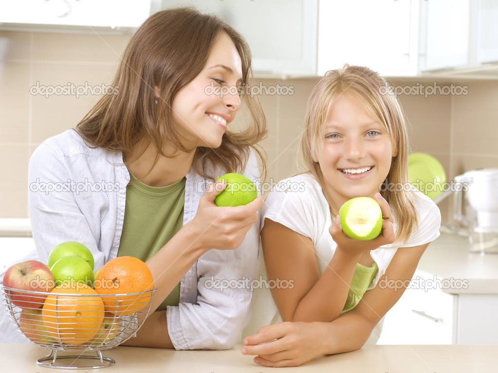 Happy Family Mother with her Daughter eating Healthy food. Diet. Healthy Eating Concept  Stock Photo #10747932