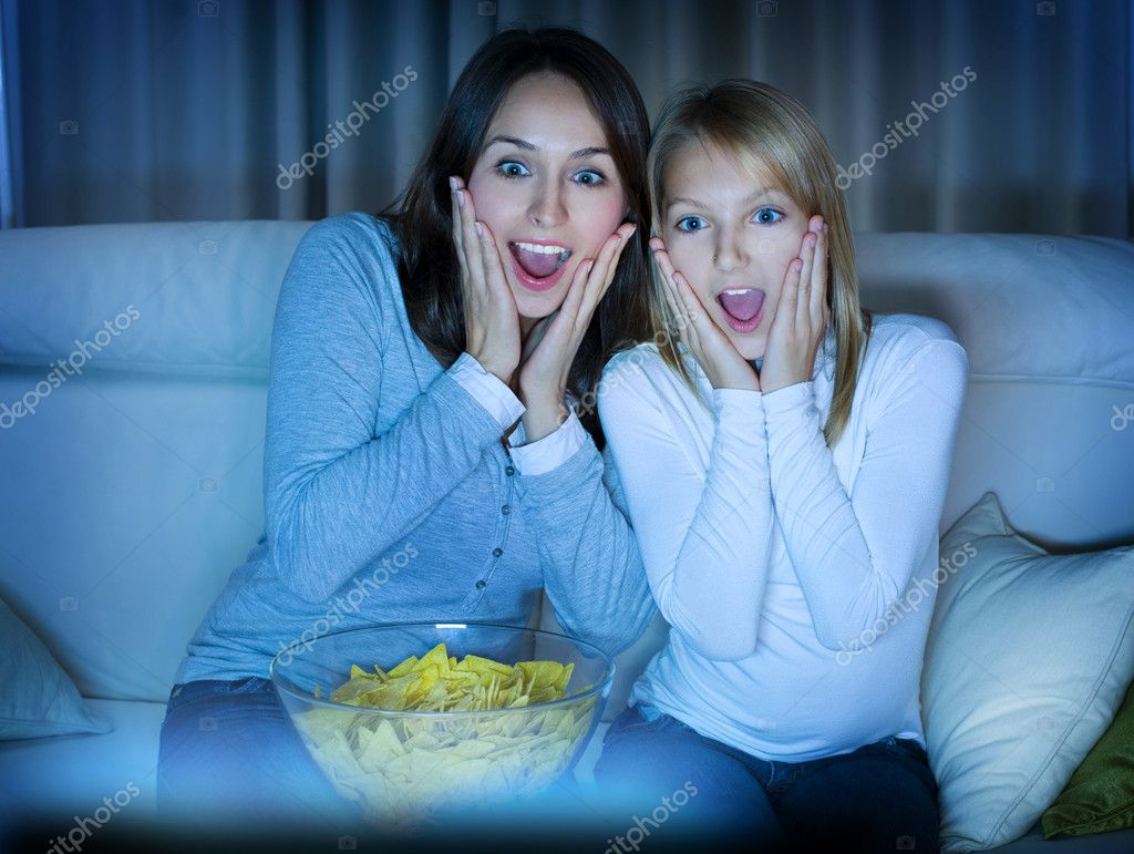 Mother and daughter watching movie