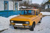 Old soviet car in village — Stock Photo