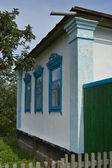 Facade of old village house — Stock Photo