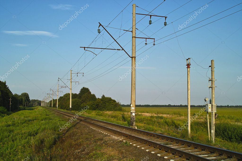 Electrified railway in sunny summer day — Stock Photo #10095327