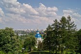 Orthodox church in park on city background — Stock Photo