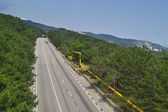Motorway in mountain forest — Stock Photo