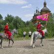 Riding cossacks with flags - Stock fotografie