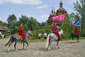 Riding cossacks with flags — Stock Photo