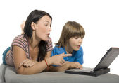 Mother and son are using laptop — Stock Photo