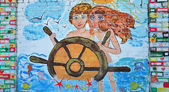 Girl and boy at the helm. Graffiti — Stock Photo