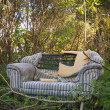 Stock Photo: Abandoned loveseat