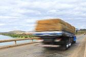 Cargo truck over bridge — Stock Photo