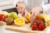 Woman cutting orange — Stock Photo