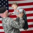 American Soldier holds his infant son — Foto Stock