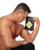 Muscle Man with Bible in Prayer — Stock Photo