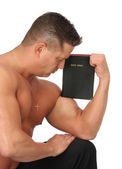Muscle Man with Holy Christian Bible — Stock Photo