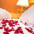 Stock Photo: Petals of rose in bedroom