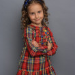 Little girl in plaid dress — Stock Photo #10413721