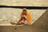 Girl on the breakwater — Stock Photo