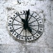 Stock Photo: Clock of church in stone