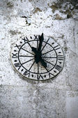 Clock of the church in stone — Stock Photo