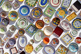 Plates of various colors, pasted on the wall, algarve, portugal — Stock Photo