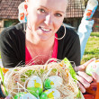 Woman and Easter eggs — Stock Photo