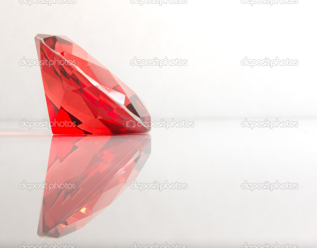 Faceted round cut red gemstone on white background  Stock Photo #10461062