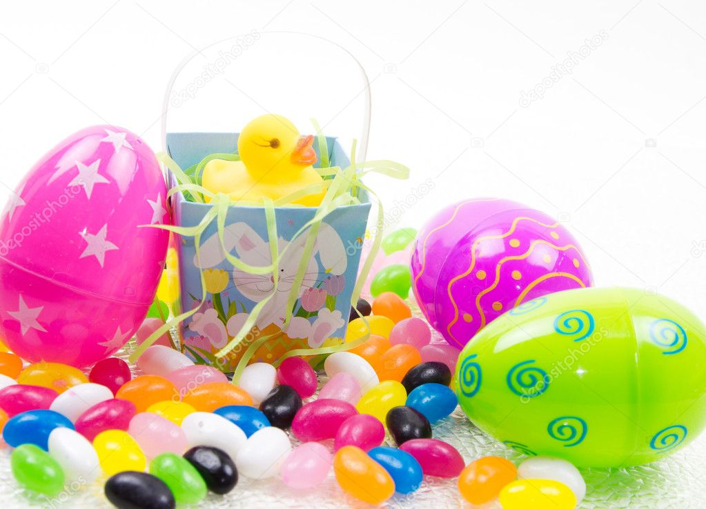 Yellow rubber duck in easter basket with easter eggs &amp; jelly beans  Stock Photo #10461270