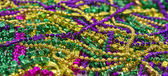 Mardi Gras Beads & Coins — Stock Photo