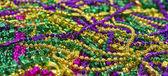 Mardi Gras Beads & Coins — Stock Photo