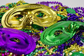 Mardi Gras Masks on a Bed of Beads — Stock Photo