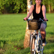 Young woman riding a bicycle — Stock Photo #10525118