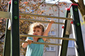 Little girl climbing the ladder — Stock Photo