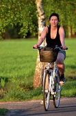 Young woman riding a bicycle — Stock Photo