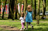 Two little girls at play in the park — Stock Photo