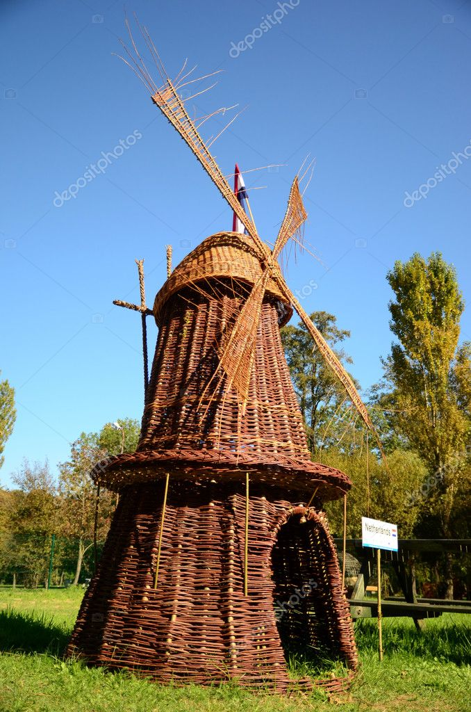 The photo shows a model of a Dutch windmill made of wicker. — Stock Photo #9817459
