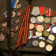 Soviet WW2 military awards on veteran chest — Stock Photo