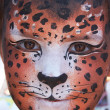 Cute girl kid face with painted panther color mask — Stock Photo