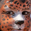 Cute girl kid face with painted panther color mask — 图库照片