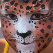Stock Photo: Cute girl kid face with painted panther color mask