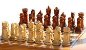 Isolated set of chess figurines on playing board — Stock Photo