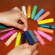 Children' s hands and crayons — Stock Photo #10547221