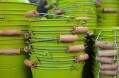 Green metal buckets with wooden handles — Zdjęcie stockowe