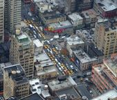 View from above to street with busy trafic and lots of yellow cabs — Stock Photo