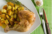 Chicken and potatoes — Stock Photo