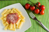 Rigatoni with tomato and parmesan cheese — Stock Photo
